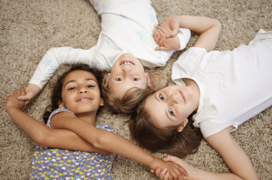 children showing the difference between fostering and adoption